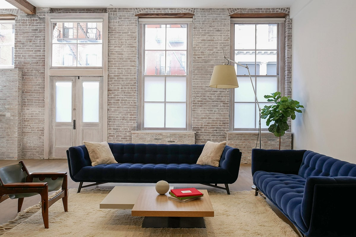 Industrial Loft Design with exposed brick in SoHo, NYC.